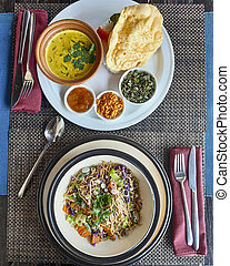 Traditional Sri Lankan dishes, curry with rice and vegetable...