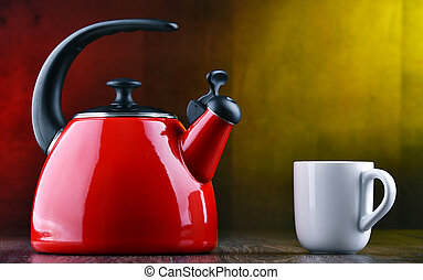 Traditional stainless steel stovetop kettle with whistle of...
