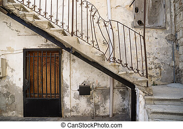 Traditional stair entrance with broken handle of Lebanese house in Tyre, Lebanon