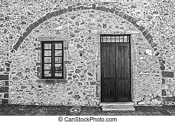 traditional stone wall, door and window at the castle of Monemvasia Greece Laconia Peloponnese Greece