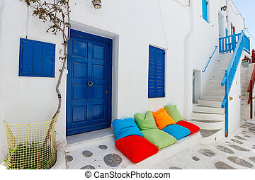 Traditional street of Mykonos island in Greece - Typical ...