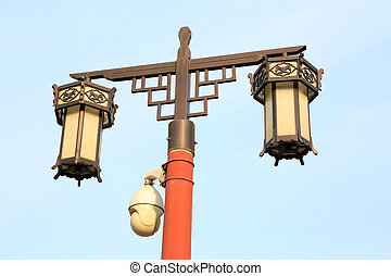 traditional style of lighting equipment and modern monitoring equipment in the Jingshan Park, beijing, china