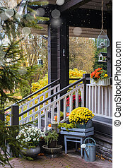 Traditional style porch, front door steps decoration at Halloween, Thanksgiving season