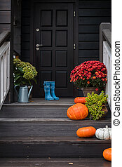 Traditional style porch, front steps decoration at Halloween, Thanksgiving season