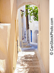 Traditional sunny street at small Emporio town in the Greek Cyclades