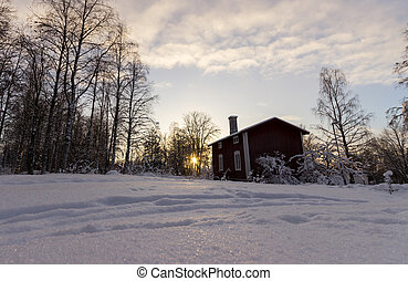 Traditional Swedish House in Winter Sunset