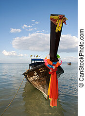 Traditional Thai boat on water