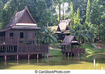 Traditional Thai House in the tropical rainforest.