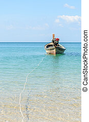 Traditional thai longtail boat at Naiyang beach with blue sky,Phuket in Thailand