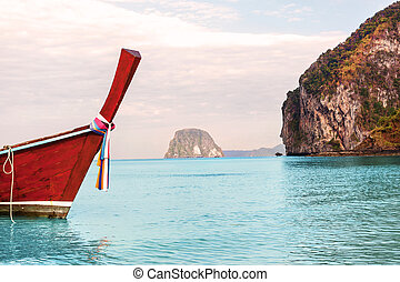Traditional thai longtail boat on summer day