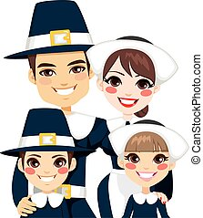 Family dressed with traditional pilgrim clothes for thanksgiving day