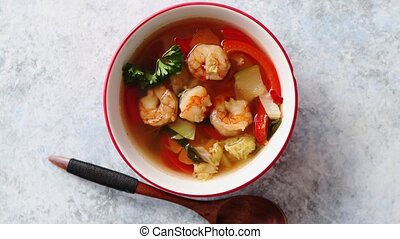 Traditional Tom Yum spicy Thai soup with shrimp, seafood, ...