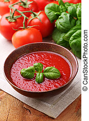 Traditional tomato soup with basil