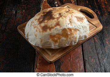 Traditional Turkish bread on rustic wooden table