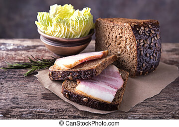 Traditional ukrainian sandwiches made of brown rye bread and smoked lard.