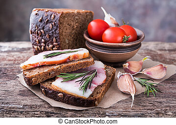 Traditional ukrainian sandwiches with brown rye bread and smoked lard.