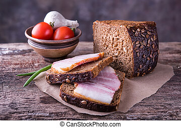 Traditional ukrainian sandwiches with brown rye bread, smoked lard and onions.