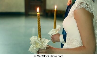 traditional Ukrainian wedding ceremony of gentle happy gorgeous couple, old church