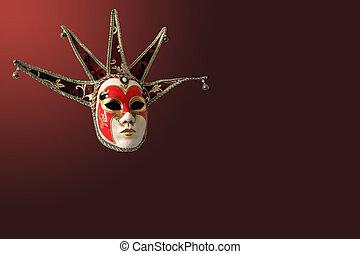 Traditional Venetian mask on burgundy background