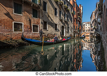 Traditional Venice Gandola Ride along Narrow Canal, Venice, Italy