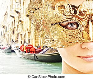 Traditional Venice gandola ride - Woman with carnival mask ...