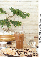 Traditional Vietnamese, Thai Ice coffee with beans on wooden background
