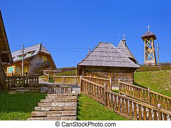 Traditional village Drvengrad Mecavnik in Serbia - architecture travel background