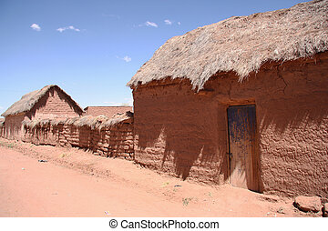 Traditional village with clay buildings in Bolivian Altiplano, Bolivia