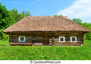 Traditional village wooden house in green country area