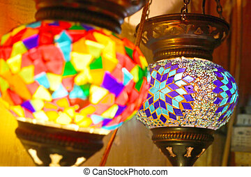 Traditional vintage Turkish lamps over light background in the night