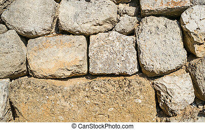 Traditional wall of stones built without lime. Dry stone wall.