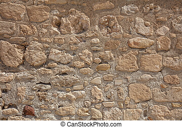 Traditional weathered stone wall background in Cyprus