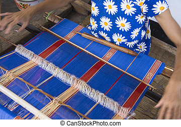 Traditional weaving - Traditional textile weaving in a ...