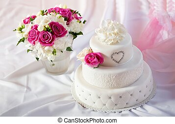 Traditional wedding cake with rose flowers - Traditional...