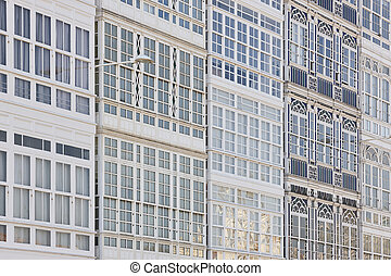 Traditional white balconies glass facades in A Coruna. Spain