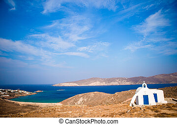 Traditional white church with sea view in Mykonos island, Greece