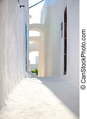 Traditional white deserted street at small town in the Greek Cyclades