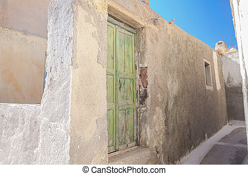 Traditional white empty narrow street at small Emporio village in the Greek Cyclades