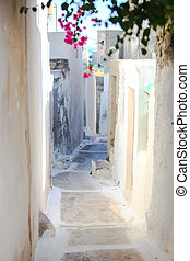 Traditional white empty street at small Emporio town in the Greek Cyclades