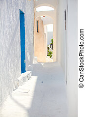 Traditional white empty street at small town in the Greek Cyclades