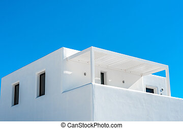 Traditional white home in the blue sky of Santorini
