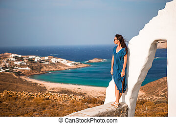 Traditional white house with sea view in Mykonos island, Greece