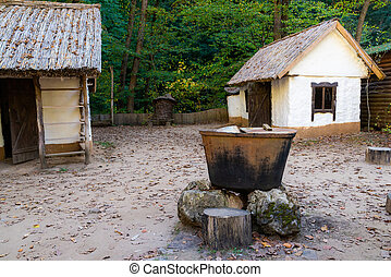 Traditional white slavic house with a thatched roof
