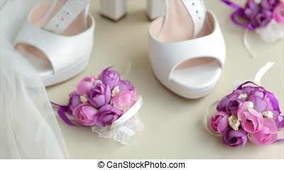 traditional white wedding shoes with beads. Whie wedding shoes. beautiful white shoes from bride. Wedding shoes on wedding dress background. Female wedding footwear. Holidays