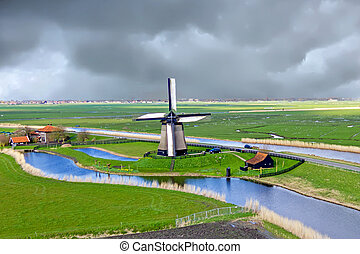 Traditional windmill in a dutch landscape in the Netherlands