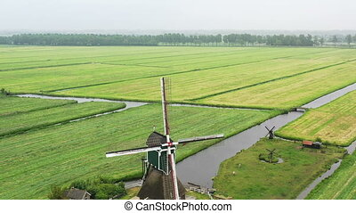Traditional windmill in the countryside from the Netherlands