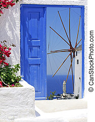 Traditional windmill of Oia at Santorini island in Greece