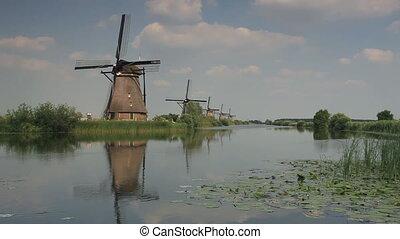 windmills on river