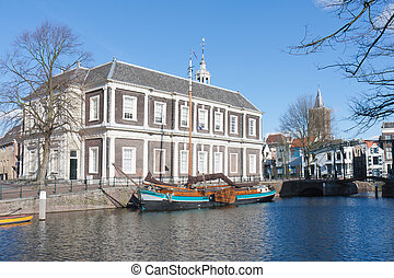 Traditional wooden barge in old historic harbor of Schiedam, The Netherlands