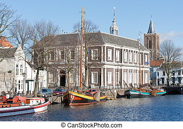 Traditional wooden barges in old historic harbor of Schiedam, The Netherlands